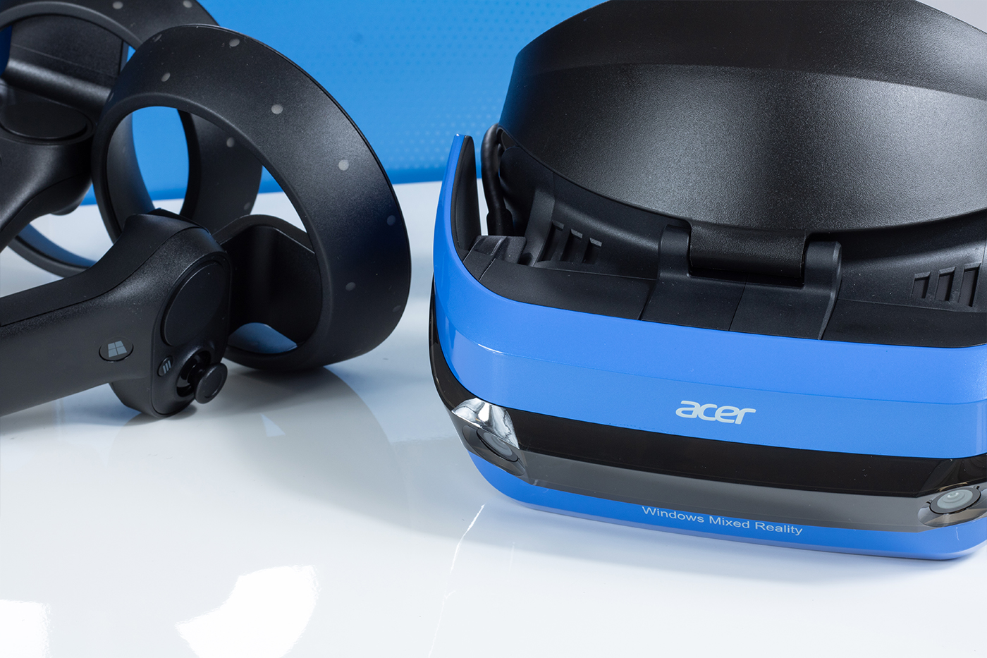 Acer Windows Mixed Reality Headset and Motion Controllers with blue retail box in background.