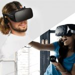 Oculus Rift vs HTC Vive - The Oculus Rift worn by a man and the HTC Vive worn by a woman in a blue t-shirt.